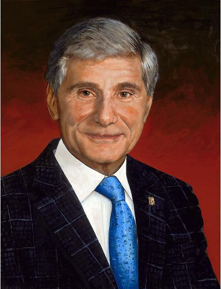 TLNPG indutee Bernard Gluckstein wearing black pinstipe suit white shirt and blue tie