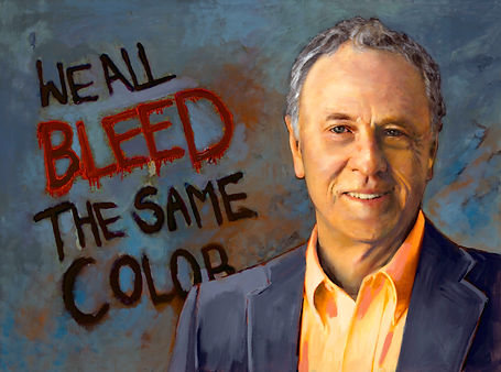 TLNPG inductee Morris Dees standng in front of graffiti