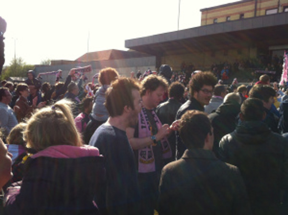 Some of the crowd are on the pitch at Dulwich Hamlet