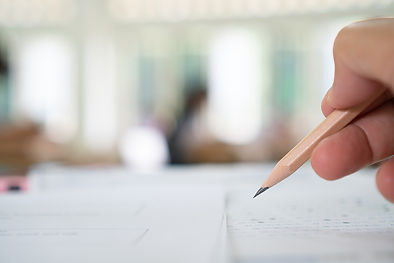 bigstock-Students-Hands-Taking-Exams-W-3
