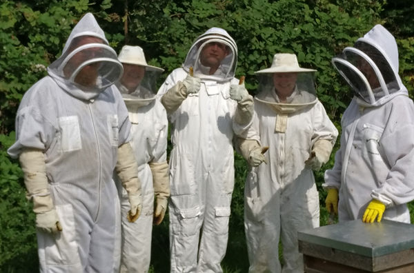 Participants of the bee keeping course suited up and ready to go. Available at the secret garden touring park