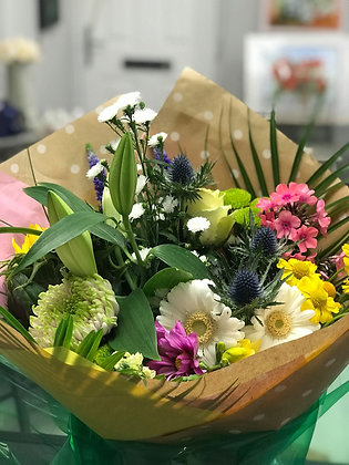 Hand tied aqua packed bouquet
