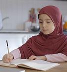 Muslim girl learning.jpg