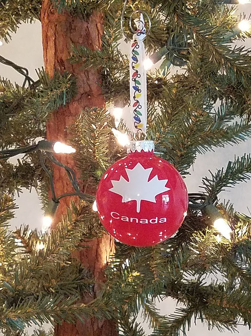Canada with maple leaf on glass ornament