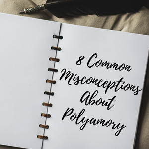 "Open notebook with the words ""Eight Common Misconceptions About Polyamory"" written in scrpt on blank page"