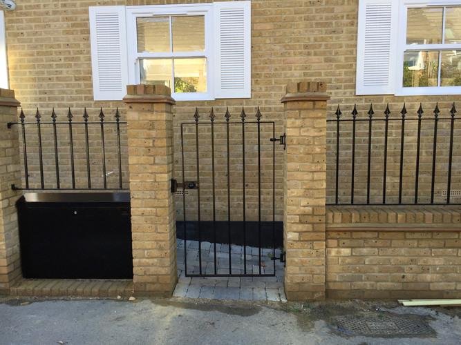 Single gate and railings.