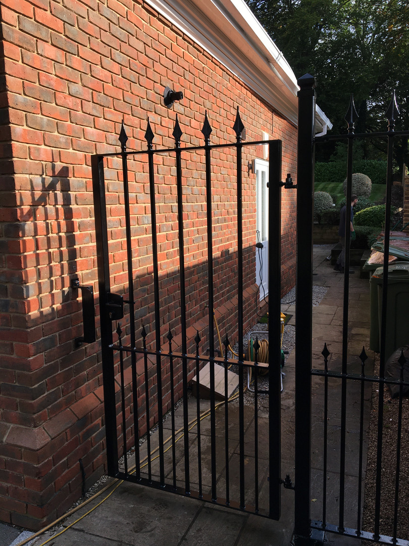 Courtyard gate and railing panel.