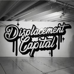 Displacement Capital