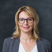 business headshot of lady in glasses