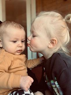 Toddler Loves Baby Brother.JPG