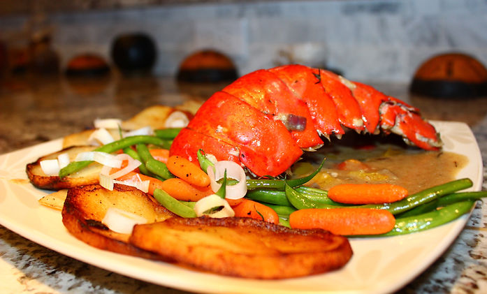 Baked lobster tail with sauteed potatoes