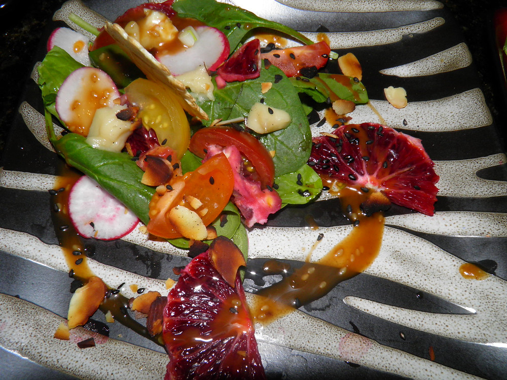 Spinach, tomato, radish and blood orange salad with a soy and sesame seed dressi