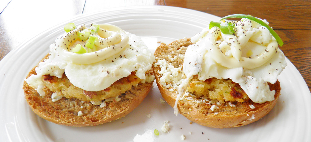 Crab eggs benedict with hollandaise sauce and guacamole.JPG