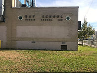 Picture of the front of the school building reading Bay School.