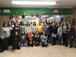 Teachers and staff with their college shirts on during College Day.