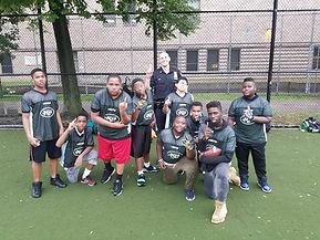 Flag football team with an officer from the 101 precinct on the PAL team.