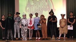 5th grade students performing a play of The Wizard of Oz.