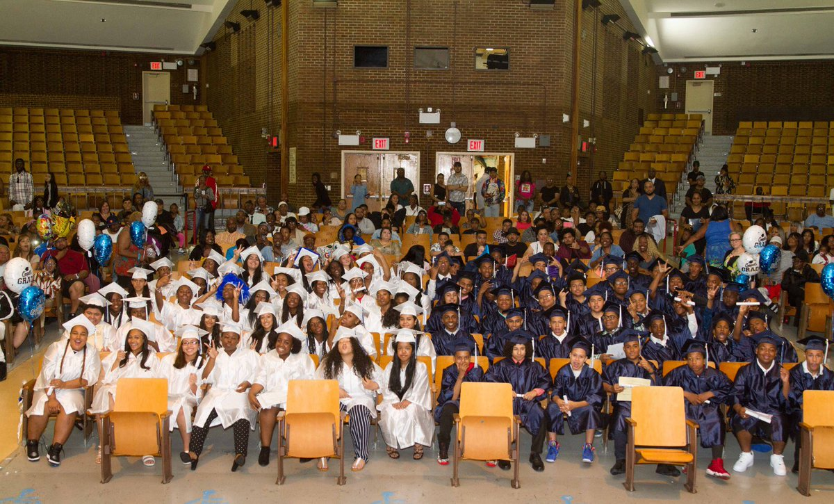 8th grade graduation showing the graduates in their cap and gowns.