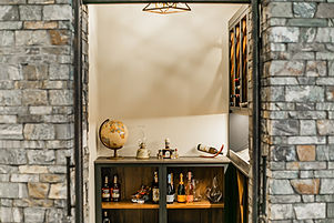 26-Wine room counters and custom wine ra