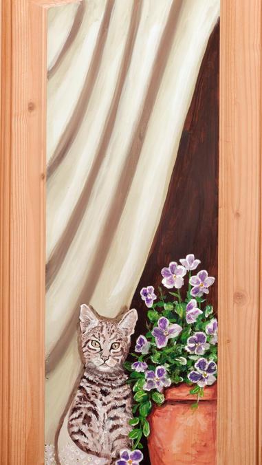 Il gattino alla finestra