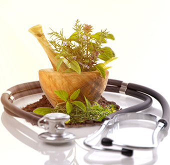 Natropathic Medicine, herbs in wooden mortar & Pestal with stethoscope