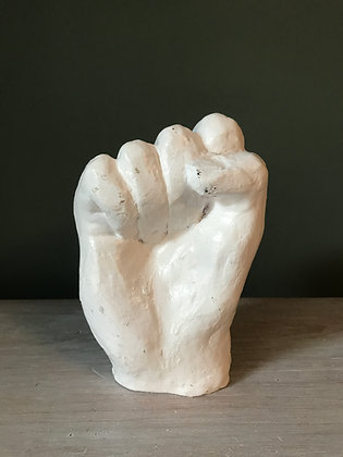 A BOXER'S FIST SCULPTURE
