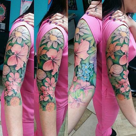 color tattoo, tattoo, flower tattoo, flower tattoo sleeve, orchid tattoo, daisy tattoo, gregg allan, tattoo gallery ocala, ocala tattoo shop, ocala tattoo, best ocala tattoo