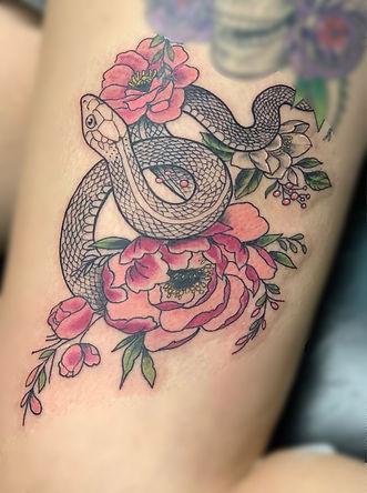 flower tattoo, flower, floral tattoo, floral, snake tattoo, snake, linework tattoo, blackwork tattoo, thigh tattoo, tattoo for women, peony tattoo, gregg allan, tattoo gallery, tattoo gallery ocala, ocala, ocala florida, ocala tattoo, belleview tattoo, summerfield tattoo, gainesville tattoo, orlando tattoo, leesburg tattoo, central florida tattoo, florida tattoo, colorful tattoo, pretty, beautiful, stunning