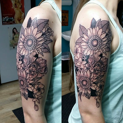 linework flower tattoo, sunflower tattoo, linework tattoo, line work tattoo, tattoo for women, gregg allan, tattoo gallery, tattoo gallery ocala, ocala tattoo,best tattoo, best ocala tattoo,