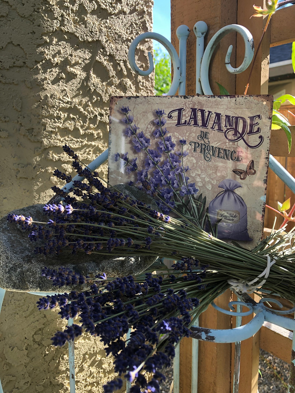 Bunches of Lavender on a Blue Chippy Lavender Stand with a Lavande de Provence Sign