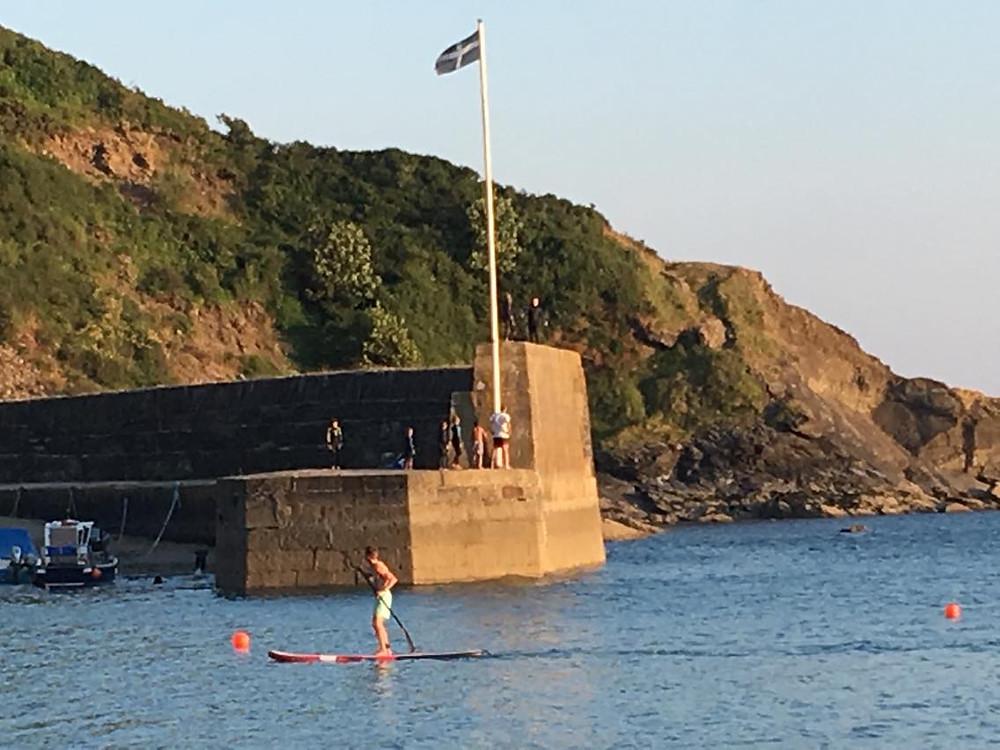 Paddle boarding at Polkerris Cornwall
