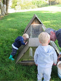 Children egg collecting on holiday at Tregolls Farm Cornwall