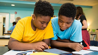 1030_two-students-looking-at-tablet-1028
