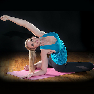 Extensa Flow instructor stretching her back