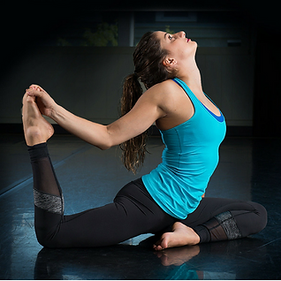 Extensa Fitness instructor stretching her quadriceps
