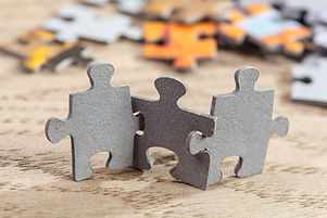 Concept of teamwork_ Three jigsaw puzzle