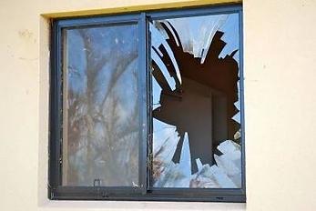 Broken-window-due-to-concrete-roof-tile-