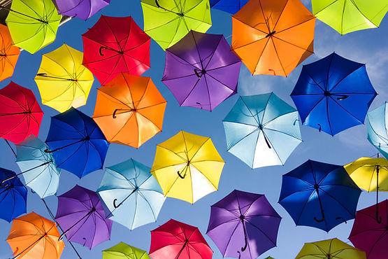 Multiple colourful umbrellas