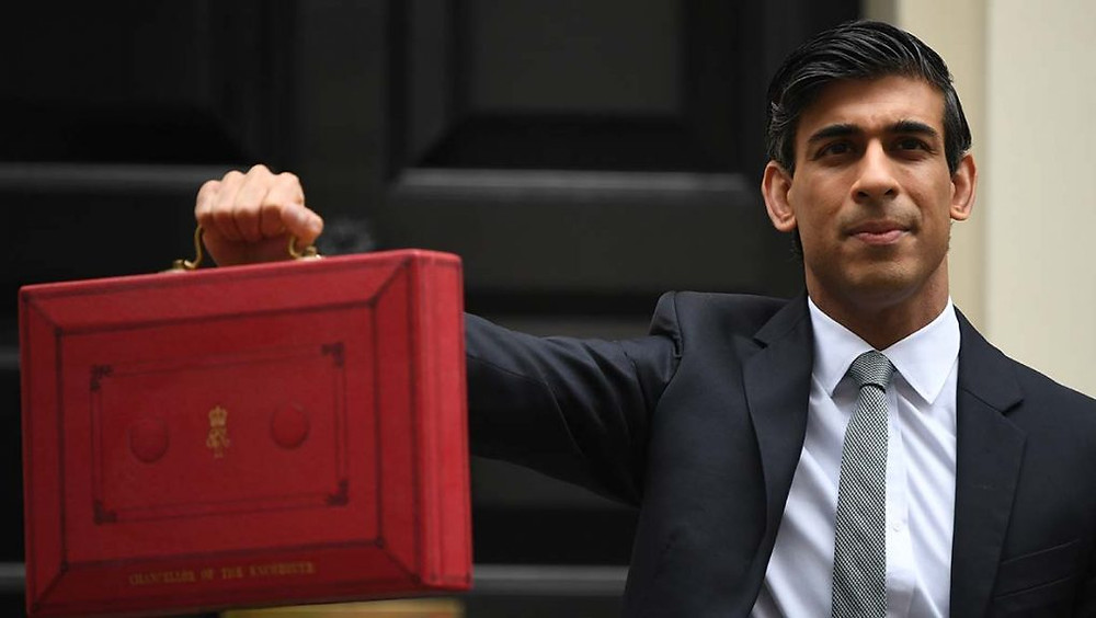 A photo of the Chancellor holding his red briefcase