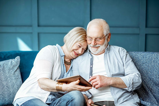 An elderly couple look at their financial plan
