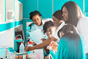 What can be done to better support women pursuing their PhDs in Africa