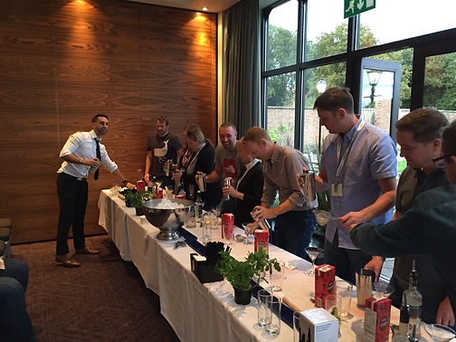 Our bartenders teaching how to make cocktails to a corporate team.