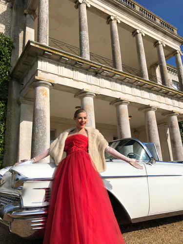 Rosie Tapner and a Cadillac Eldorado outside Goodwood House