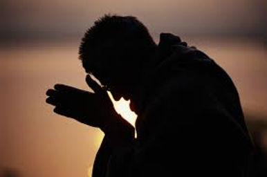 priest praying.jpg