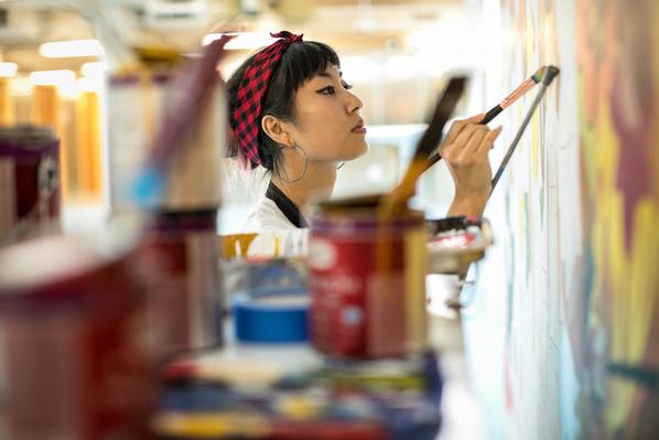 Lauren working on a mural