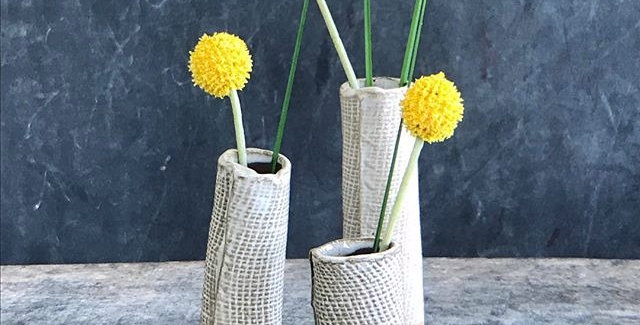 Bud vases, white on black clay