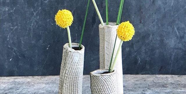 Bud vases, white on black clay