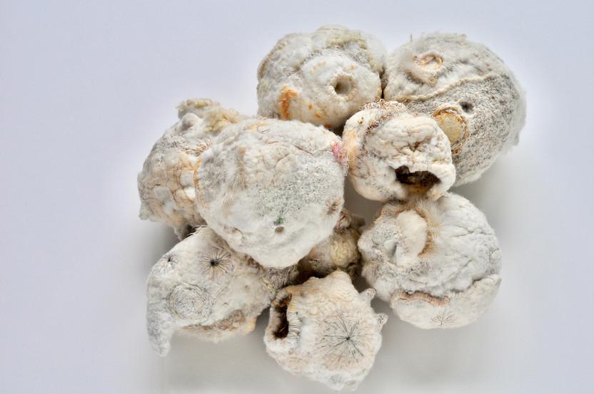 'Tactile Memory Stones', 2017-18, 10 pieces - dimensions vary (average size 12cm x12cm x12cm), Polyester fibre, paper, cotton, wool, acrylic, feathers, silk, linen, polypropylene