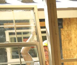 Carpenter joiner assembling installing window
