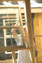 building contractor installing window